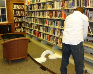 mini golfing in the library