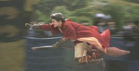Harry Potter flying during Quidditch
