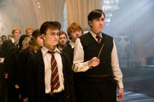 Harry teaching Neville